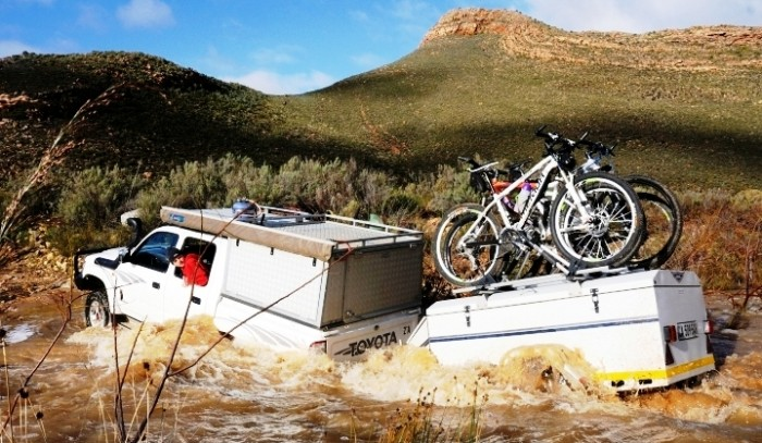 Guests crossing the Elandskloof River after some heavy rains